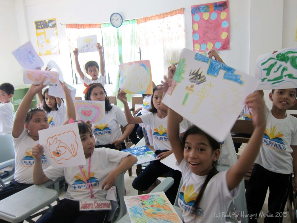 HM students proudly show their artworks