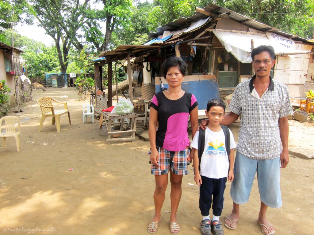 Elmark with his parents at their house in Malolos, Bulacan.